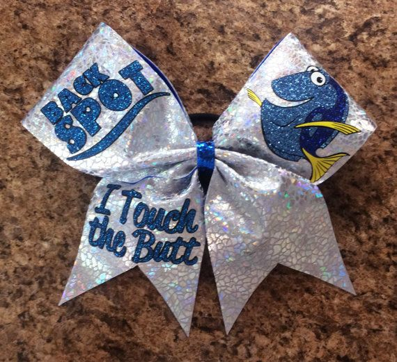 Made with 3 inch grosgrain ribbon and hologram fabric. Glitter vinyl is used for the graphics. Badda Bling Bows are handmade to order and are