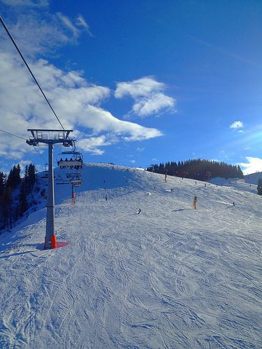 A slope and chair lift while skiing in westendorf, Austria skis