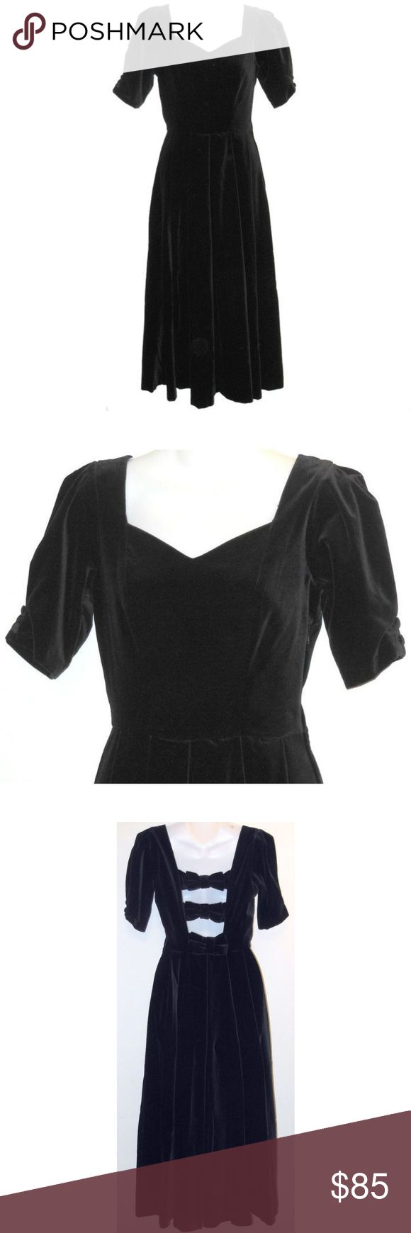 """Vintage Laura Ashley Velvet Dress Elegant vintage dress from Laura Ashley in black velvet, perfect for holiday parties. Sweetheart neckline, short sleeves and seamed waist. Cut-out back with bow trim, zips under the arm, lined to the waist. Measurements: US Size 4 Bust 33"""" Waist 25"""" Hips 42"""" Length 49"""" shoulder to hem All Measurements Are Approximate Measurements Taken Flat & Unstretched Laura Ashley Dresses Midi"""