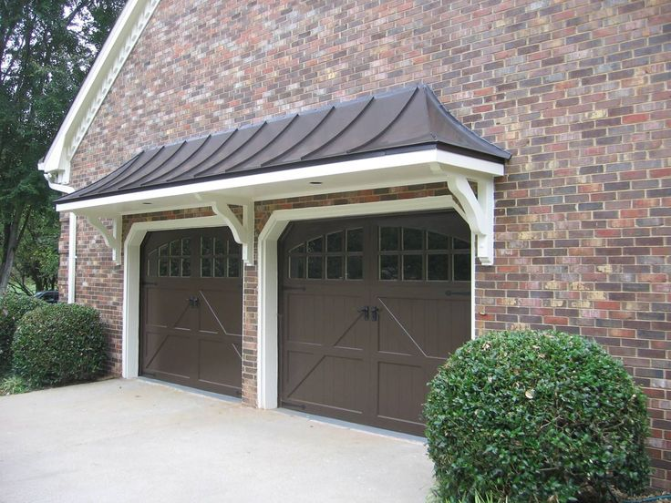 Metal roof bracket portico over double garage doors. Designed and built by Georgia Front Porch.
