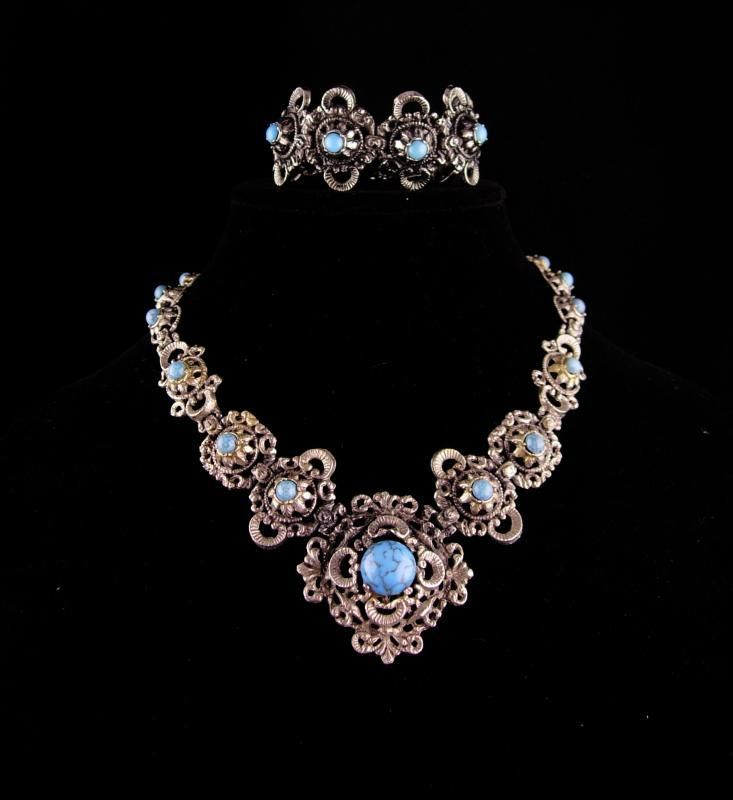 WOW ! WHAT a fantastic full victorian revival demi parure~!. ! It is really well made with elaborate heavy metal work that encompass these gorgeous faux turquoise stones. The detailed bracelet has unusu