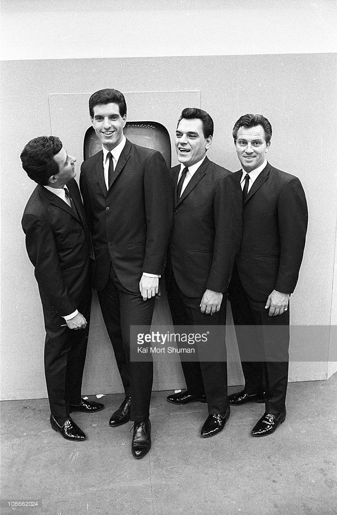 Frankie Valli, Bob Gaudio, Nick Massi and Tommy DeVito of the doo wop group 'The Four Seasons' pose for a portrait at the Democratic National Convention on August 26, 1964 in Atlantic City, New Jersey.