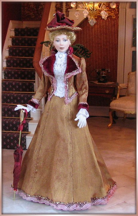 Philippa is a lady from around 1896. She is wearing a Paris Autumn Toilette. Outside it might rain, so she has a matching parasol, just in c...