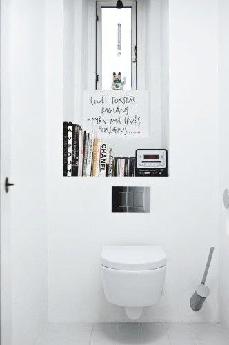Although I've never been one to sit and read on the toilet...this looks so darn great if I used this bathroom I might have too