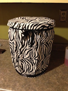 Storage and covers the whole bucket.....using a pillowcase! A First Grade Teacher's Passions and Obsessions: My Jungle Version of a Crate Seat~Bucket Style!