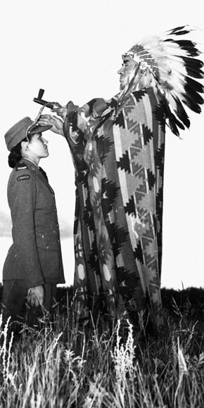 """Mary Greyeyes being blessed by her native Chief prior to leaving for service in the CWAC.""  September 29, 1942.  Mary Greyeyes (Reid) was the first Native woman to join the Canadian Forces and one of only 25 Native women to serve in the Canadian military during World War II.  The photo is staged according to Mary's daughter in law."