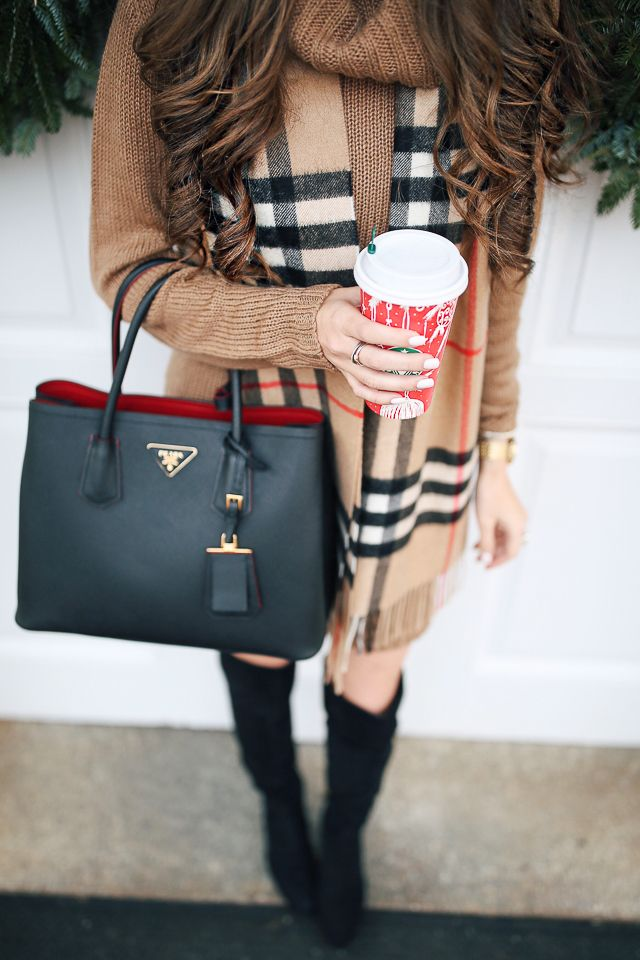 Burberry scarf, camel sweater dress, black Prada bag, tall black suede boots, and Starbucks red cup