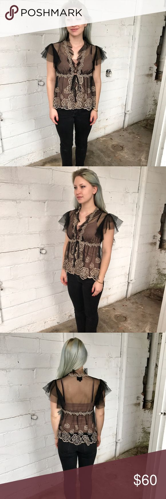 ANNA SUI top! This is a beautiful ANNA SUI black mesh polynet with gold rose embroidery top! Has a tie in the front, so it could be worn open! Measures 21 inches in length, bust measures 15 inches and waist when fully tied measures 14 inches. Anna Sui Tops Blouses