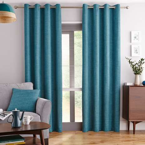 Add a touch of freshness to your home with this pair of teal ready made curtains, featuring a woven texture completed by an eyelet header to create sophisticate...