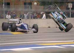 Schumacher (right) and Hill (left) crash at the Flinders Street corner during 1994 Australian Grand Prix.