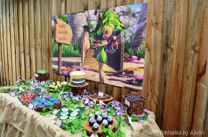 Fun Dessert Table and Backdrop at this Tinkerbell Party with Lots of Really Cute Ideas via Kara's Party Ideas | KarasPartyIdeas.com #Tinkerbell #Fairy #PartyIdeas #PartySupplies #DessertTable #Backdrop