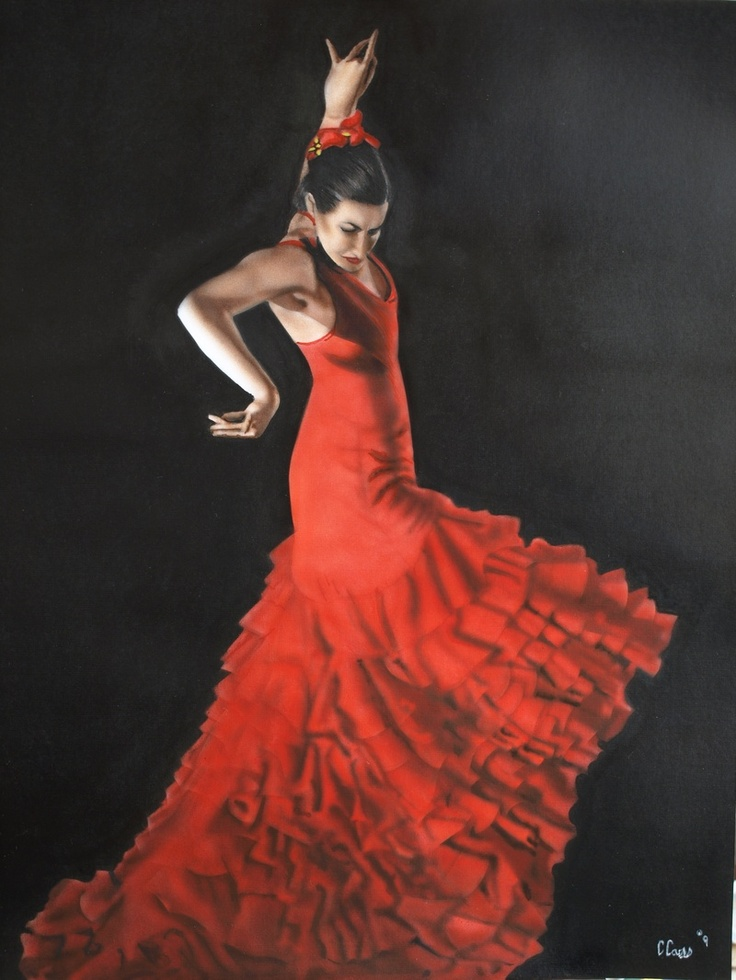 Lady in red dress dancing on beach