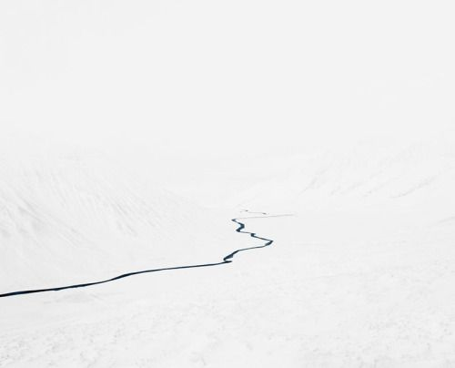 landscape-photo-graphy:  Streams by Jonathan Smith   Brooklyn-based photographer Jonathan Smith has abstractly captured Iceland's northernmost region of streams in the remote fishing town Siglufjörður. The images in Streams artistically depict a desolate frozen land with deep blue water streams in alternate perspectives. Its juxtaposition between up-close and distant shots create an aura of mystery, making it difficult for the viewer to decipher the photographs in front of them. The…