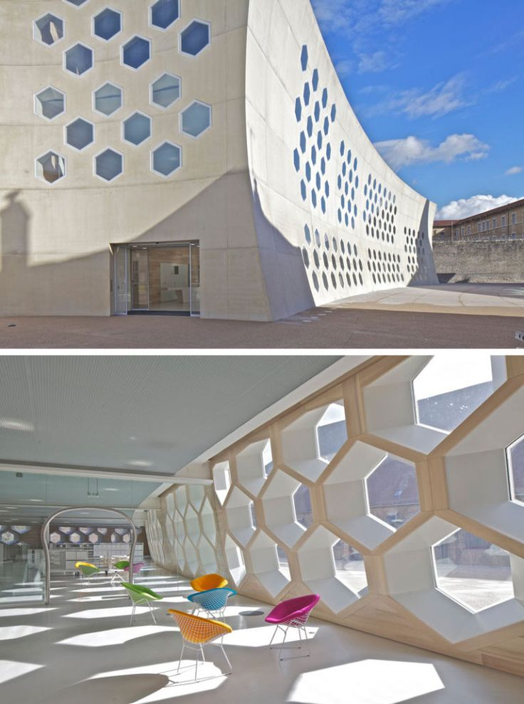 19 Ideas For Using Hexagons In Interior Design And Architecture // All of the windows on this library/cinema in France, are hexagons that look out onto the streets of Lons-le-Saunier.