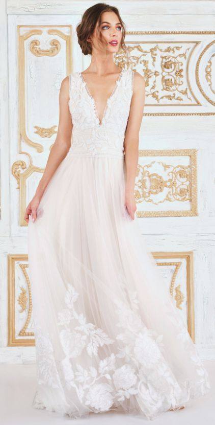 Featured Dress: Tadashi Shoji; Wedding dress idea.