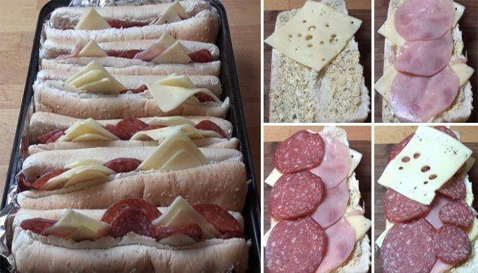 Horký italský sendvič s česnekovým máslem, šunkou, salámem a sýrem