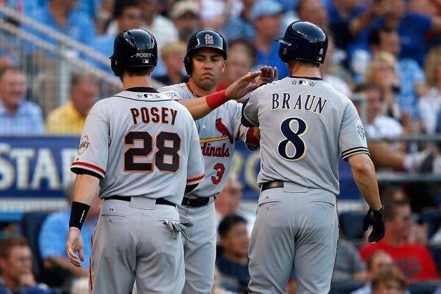 National League All-Stars Buster Posey #28 of the San Francisco Giants, Carlos Beltran #3 of the St. Louis Cardinals and Ryan Braun #8 of the Milwaukee Brewers score on a three-run triple by Pablo Sandoval #48 of the San Francisco Giants in the first inning during the 83rd MLB All-Star Game at Kauffman Stadium on July 10, 2012 in Kansas City, Missouri. Photo: Jamie Squire, Getty Images / SF