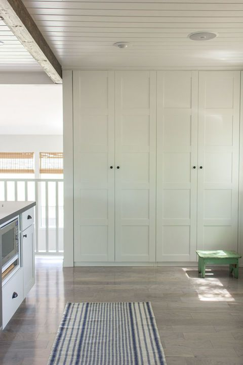"Nothing says ""fancy"" quite like a built-in pantry. These Bergsbo-style IKEA cabinets provide hidden storage in a space that was otherwise a bare wall without a purpose. See more at Jenna Sue Design Co. »"