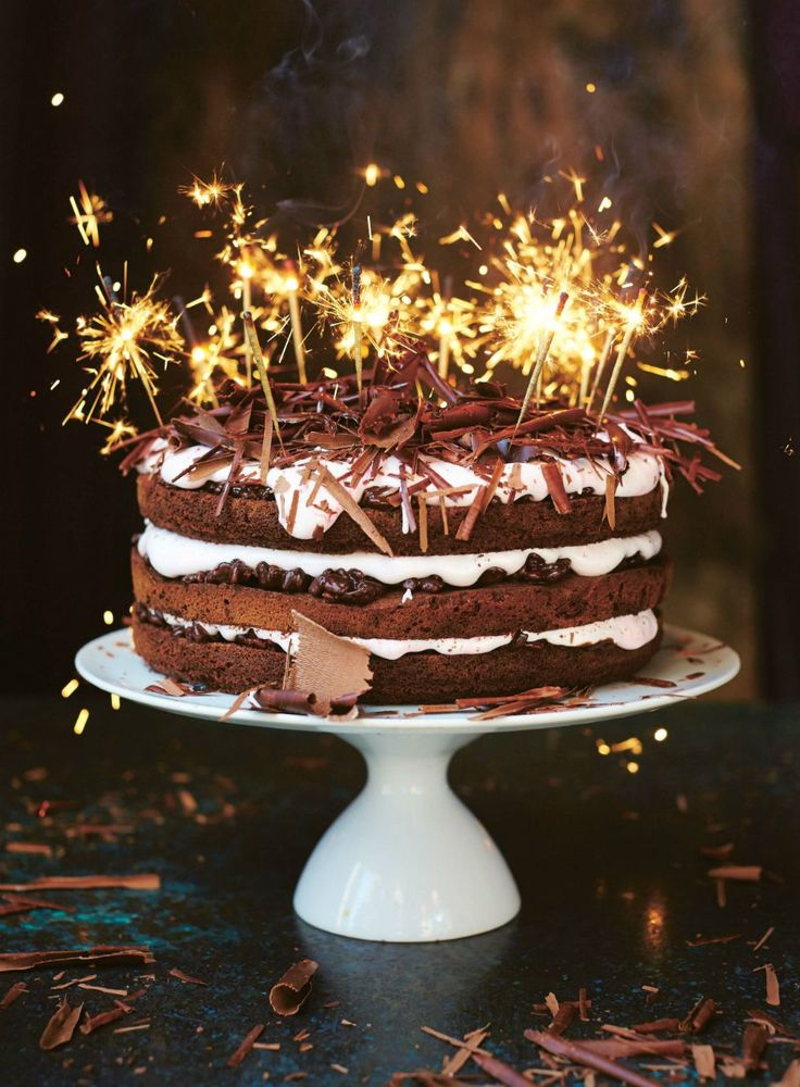 Chocolate Celebration Cake ~ stacked layers of chocolate sponge, chocolatey puffed rice, and nougat frosting | recipe by British chef Jamie Oliver from the book 'Jamie's Comfort Food' | via The Happy Foodie