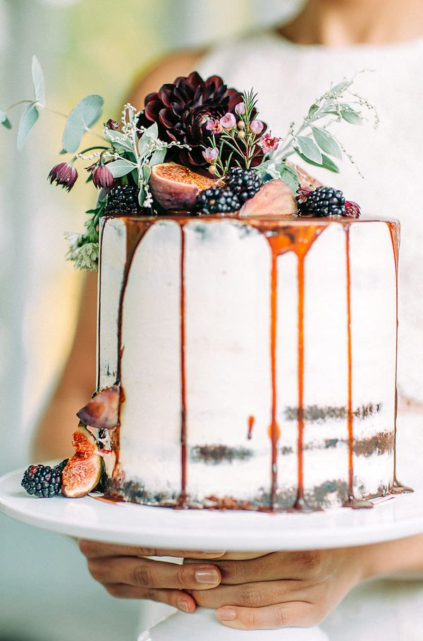 Naked wedding cake with fruit and drizzle