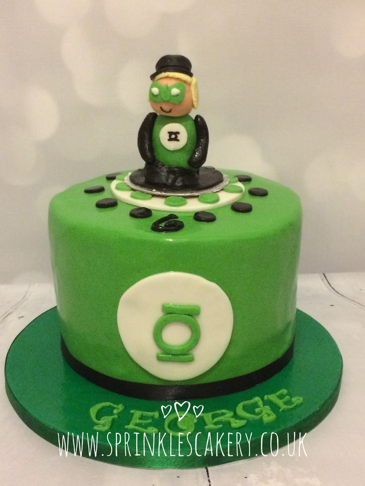 A green lantern fondant topper (modelled on the birthday boy) topped off this fondant coloured chocolate cake.