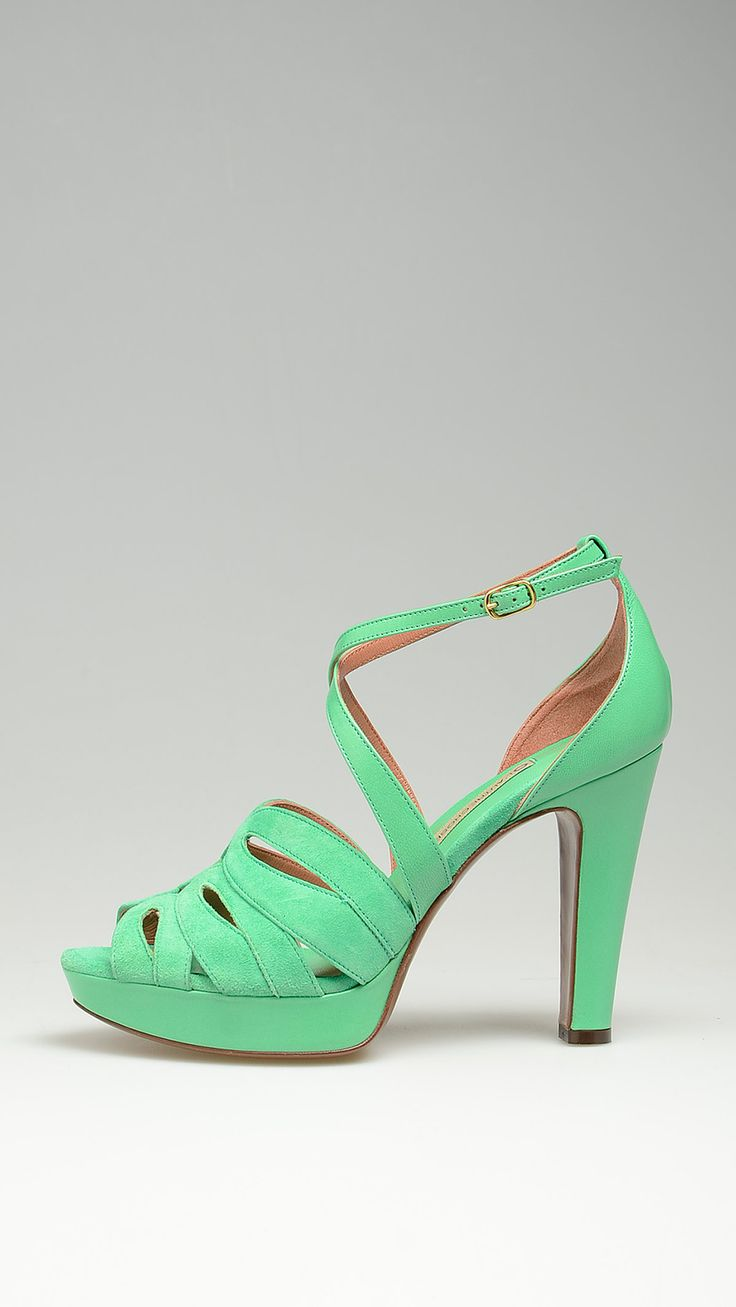 Heeled sandals featuring green suede cross over straps, leather buckled ankle strap, 4.3