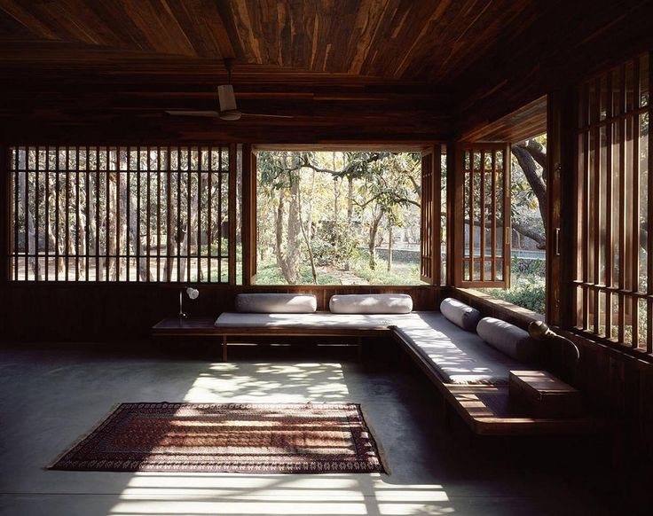 rustic zen interior design with wide glass window also brown rug on floor