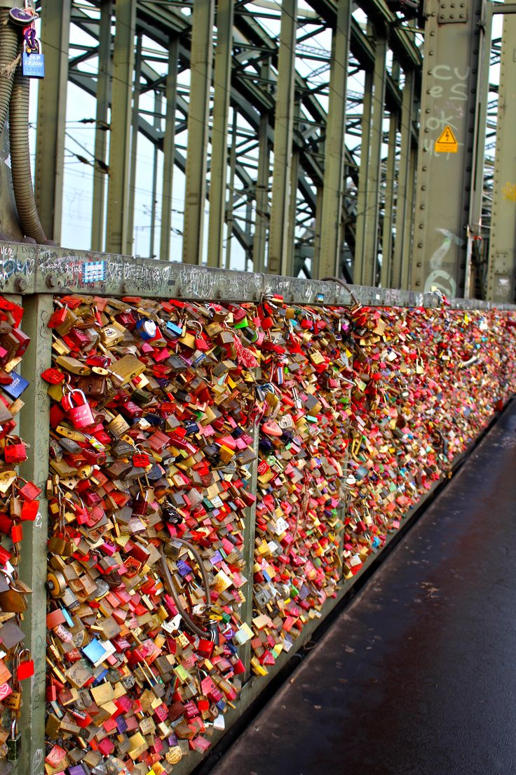 The Hohenzollern bridge in Cologne, Germany is no different. This bridge crosses the Rhine River and is said to have over 40,000 love locks attached to it.