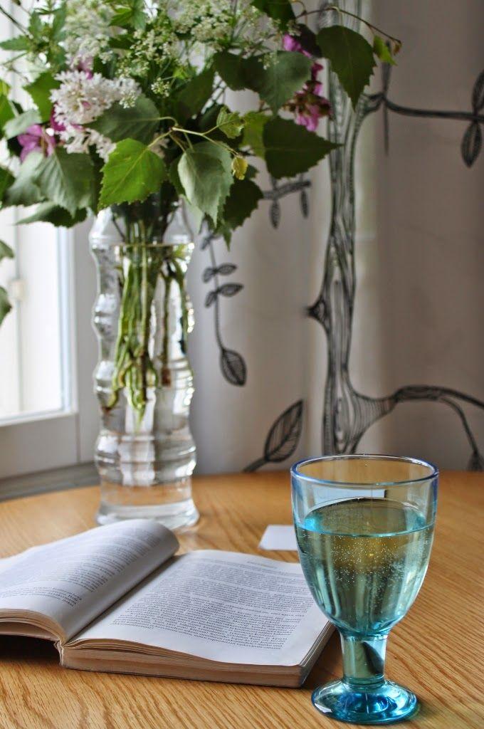 Good book and a glass of white wine - perfect summer evening :)    http://omankatonalla.blogspot.fi/2014/06/sielta-taalta.html