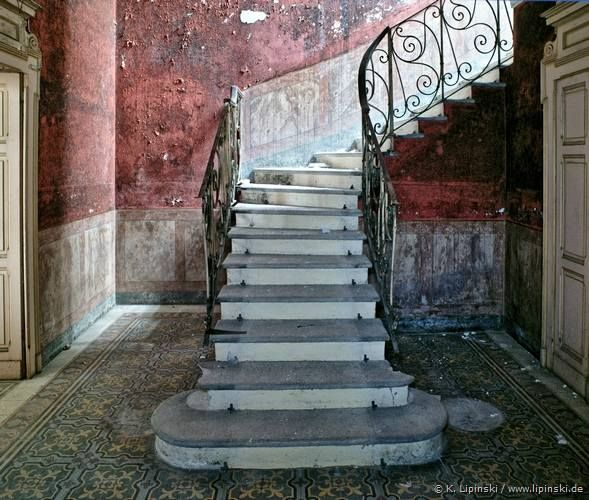 Beautiful staircase in abandoned mansion