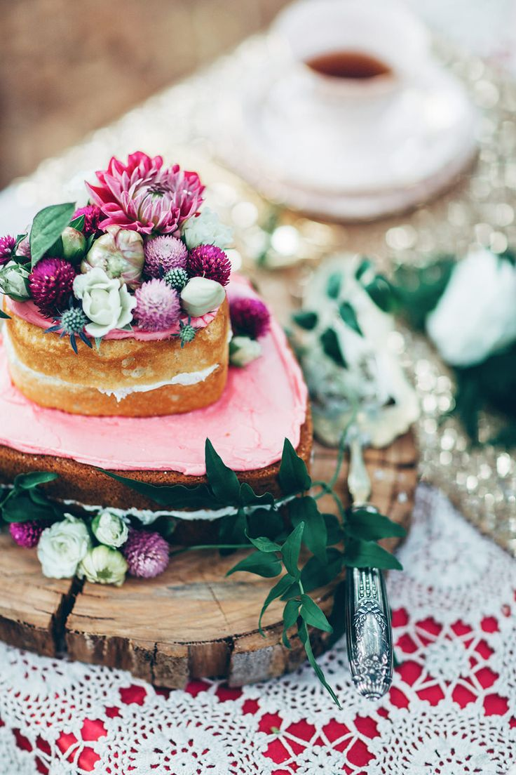 Heart shaped naked sponge cake on wooden slabs - Image by Miss Gen - Alice In Wonderland Mad Hatters Tea Party Inspired Wedding Inspiration Shoot Using Top Australian Wedding Suppliers Rockstars And Royalty Swish Vintage And Peony N' Pearl With Images By Miss Gen Photography