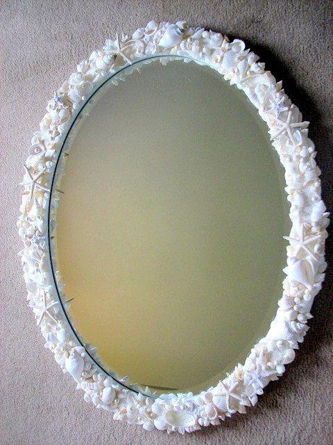 Beach Decor Shell Mirror - Nautical Seashell Mirror w Starfish, Sand Dollars & Pearls - White. $1,100.00, via Etsy.