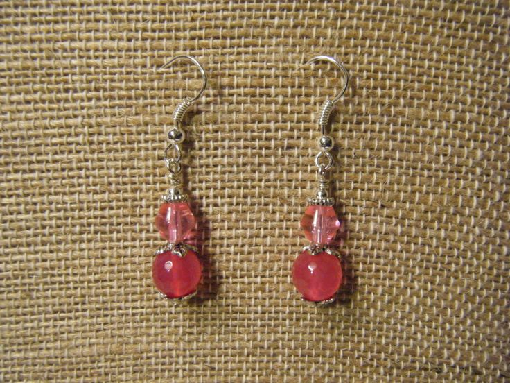 Pink glass beads with silver accents.