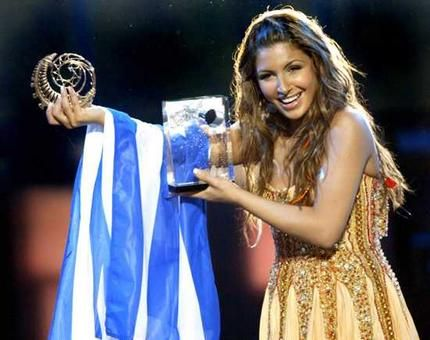 Elena Paparizou, love her, she's adorable and again like the majority of Greek artists has so many good songs, ones that make you want to dance!