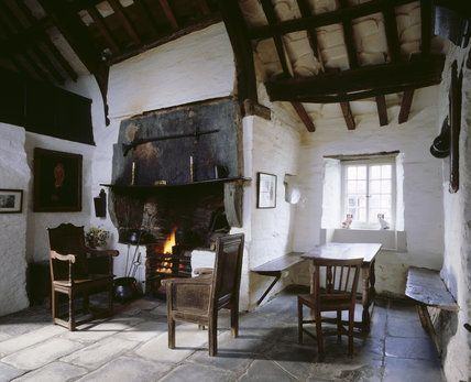 The hall inside the Old Post Office at Tintagel, looking to the open fire Well worth a visit...but be warned it is a very busy place in high summer!