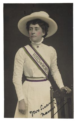 UK -- The 'Suffragette Look' as worn by Norah Balls. The suffragette uniform was introduced in 1908. During the winter months members of the WSPU were required to wear 'full dress uniform' of a ' white frock with regalia and colours' to all indoor meetings and breakfast receptions. During the summer months this uniform was also worn to all outdoor processions and rallies.     Artist/Photographer/Maker  Women's Social and Political Union
