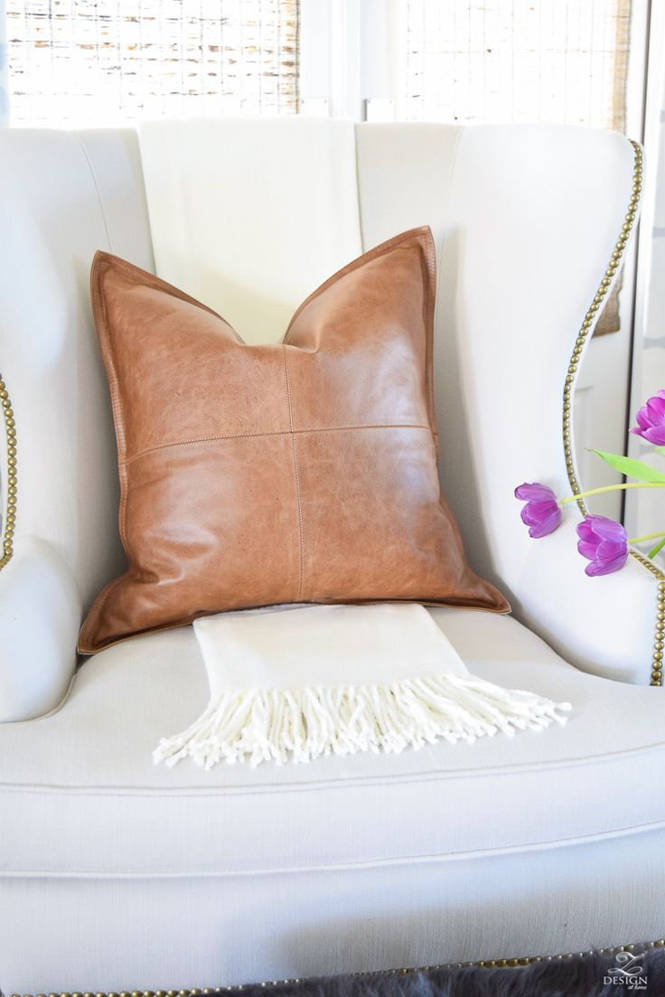 Pottery Barn leather pillow purple tulips light gray wingback chair with brass nail heads white fringe throw -1