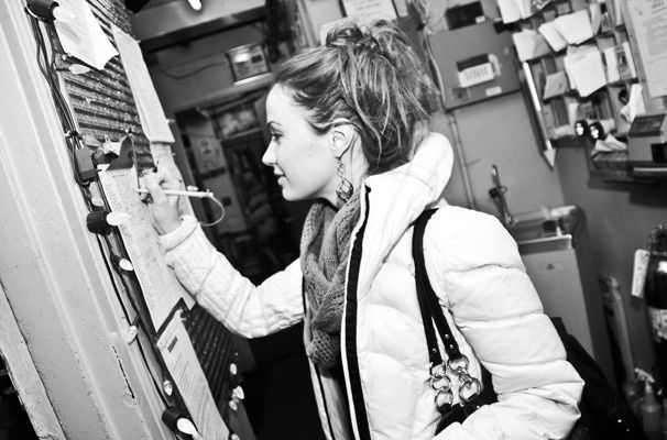 Photo 1 of 26 | Even a blizzard won't stop Sierra Boggess from getting to work on time! All bundled up, the actress signs in on the Phantom call board. | Angel of Music! See Sierra Boggess' Backstage Transformation at The Phantom of the Opera | Broadway.com