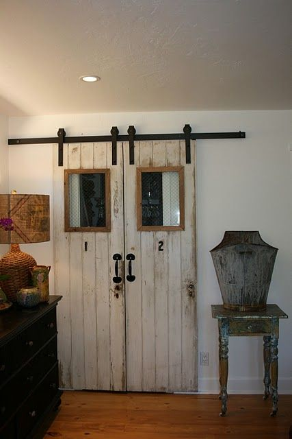 double barn doors--this would b e cool for a home ofice or theater room, a room that would be great open or closed off--the doors are a great functional decor piece!