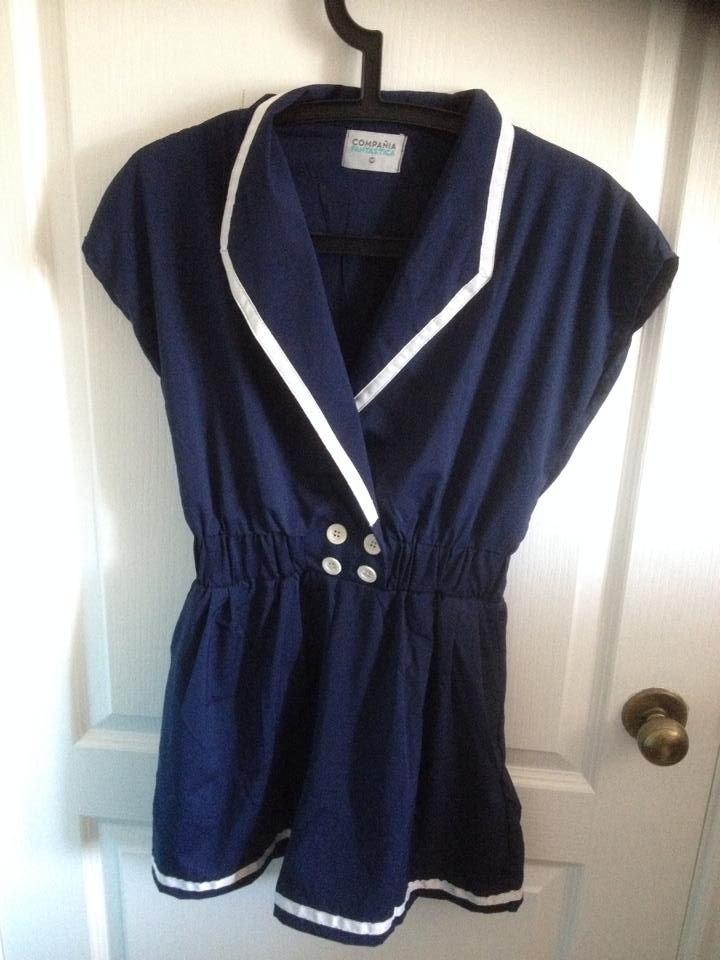 Nautical romper by la compana fantastica. Size is medium. This is super adorable, but fair warning: if you are busty, it is a pain to put on since the fabric has no stretch! 15$ + shipping
