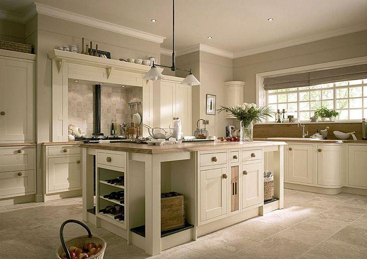 Ivory vanilla kitchen with khaki walls and white trim for Ivory kitchen ideas