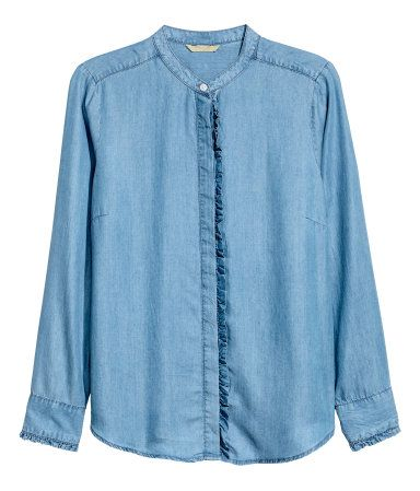 Denim blue. CONSCIOUS.  Shirt in denim made from Tencel® lyocell. Henley collar, concealed buttons with ruffle-trimmed placket at front, and long sleeves