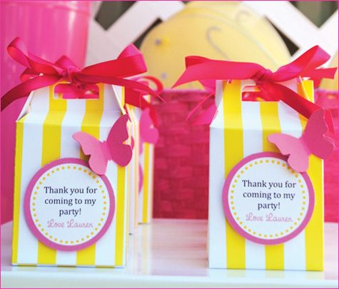 Signature colors and a bold yellow wide stripe pattern throughout all the paper products – from the cupcake toppers and adorable favor boxes to the fabrics on the dessert and favor tables.