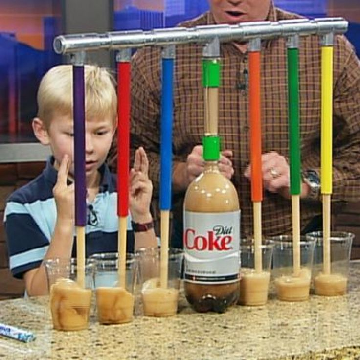 Mentos Soda Pop Drop - Steve's son, Jack Spangler, decided that it is just too hard to pour soft drinks by turning a 2-liter bottle of soda upside down. The bottle is just too heavy. So Jack decided to use the power of Mentos and Diet Coke to fill 6 glasses at once and solve his problem.   ||  Steve Spangler Science