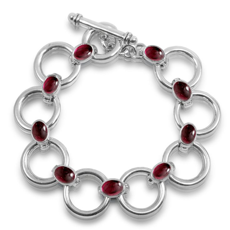 Silver Bracelet Garnet  Silver circle bracelet with 7 garnet cabouchons (5 mm) and fob – model B14. Each silver bracelet garnet cabouchons are carefefully selected to match perfectly. A piece of fine jewellery that's made to last for generations. Fine Jewellery South Africa
