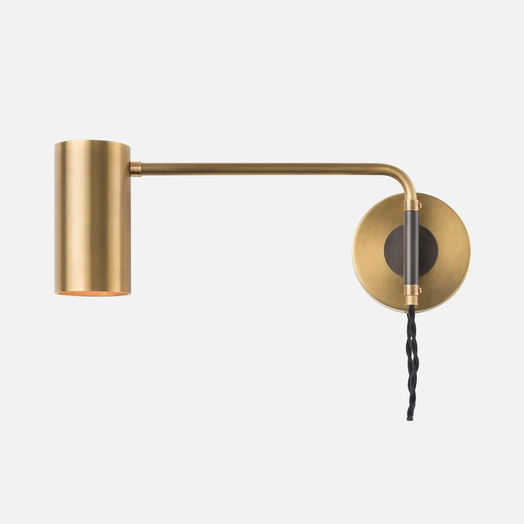 Evoking the lines of mid-century modern design, the Envoy Swing Sconce offers an elevated take on the utilitarian. Ideal for task lighting, the solid brass swing arm rotates to deliver light wherever it's needed, while the modern mix of brass, steel and twisted cloth cord bring sophistication to any interior.   Designed with an eye for the details, the solid brass cylindrical shade releases a warm glow above and below. Pared down to essential elements and clean lines, each custom component…