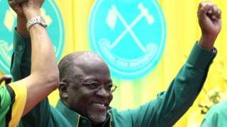 Image copyright                  AFP             Image caption                                      President John Magufuli has a reputation of being a no-nonsense leader                               Tanzanian public broadcaster TBC has suspended nine staff after it aired a...