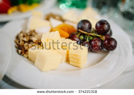Tasty appetizer.  Plate of Cheese on white plate at a restaurant