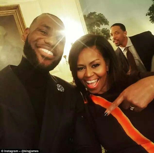 James and the First Lady pose for a selfie as Frye photobombs in the background  Read more: http://www.dailymail.co.uk/sport/othersports/article-3926678/LeBron-James-Cleveland-Cavaliers-Mannequin-Challenge-Michelle-Obama.html#ixzz4PokbNpvU  Follow us: @MailOnline on Twitter | DailyMail on Facebook
