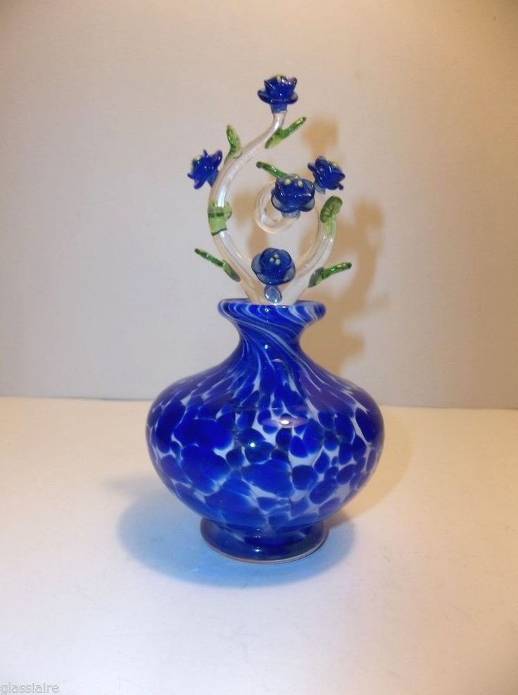 72 best blue glass flowers images on pinterest glass for Flowers in glass bottles
